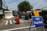 Tanpa Penjagaan, Pengendara Terobos Pos Penyekatan Jalan Raya Bogor