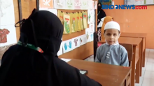 Merdunya Lantunan Ayat Suci Al-Quran dari Hafiz Cilik Disabilitas